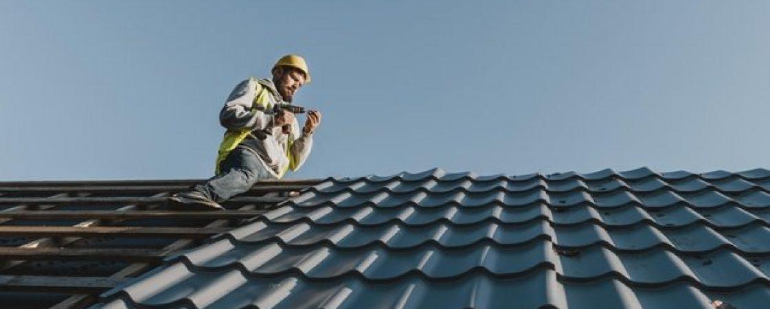 long-shot-man-working-roof_23-2148748777